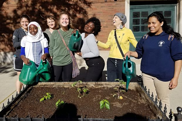 Teenage girls who are refugees in Chicago planted vegetables outside the Broadway Armory, the site of  cooking classes that explore foods with significance in their countries of origin.