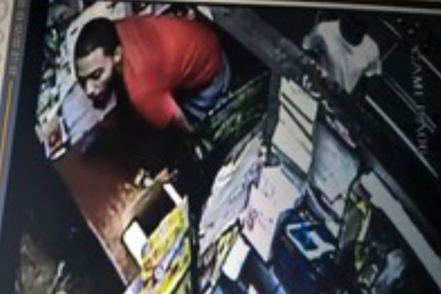 Police are looking for a man they say hit a grocery store employee in the head with a credit card transaction machine then snatched cash from the register.