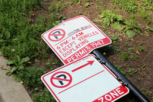 Parking ban signs installed on the Near West Side aimed at curbing gang parties have been vandalized before the ban was set to begin.