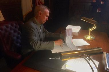 Gov. Bruce Rauner vetoes the budget approved by the Illinois General Assembly on the Fourth of July.