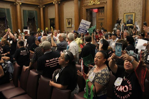 Protesters of two large development joined forces to shut down a public hearing on both of their rezonings at Brooklyn Borough Hall Monday night.