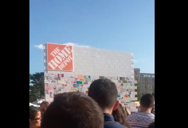 A Home Depot promotion for bathroom tile ended up sparking a protest over President Donald Trump's proposed border wall at a Latin alternative music festival over the weekend.