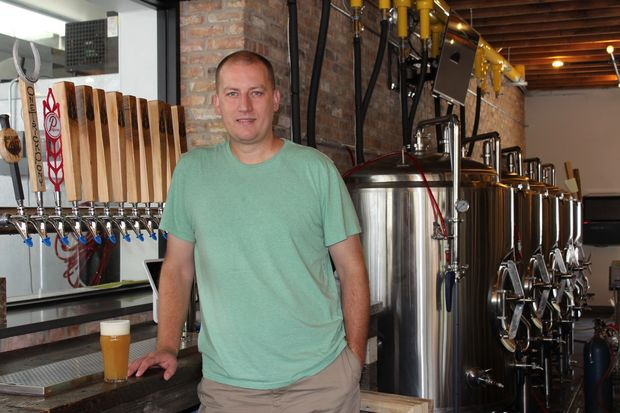 John Brand will debut Open Outcry Brewing Co. Friday at 10934 S. Western Ave. in Morgan Park. The brewery will feature Brand's beer unique recipes and a kitchen serving Neapolitan pizzas and more.