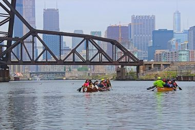 A group canoes on the South Branch of the Chicago River near Ping Tom Park in Chinatown