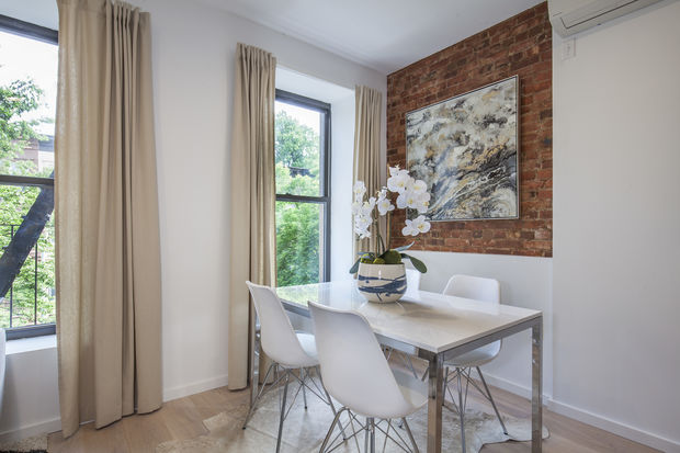 This two-bedroom, two-bath condo with a washer-dryer and other modern touches in a landmark brownstoen at 43 Halsey St. in Bed-Stuy is listed by Douglas Elliman for $799,000 — right around the median price for Brooklyn.