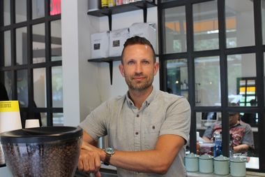 Aaron Cook opened Three Seats Espresso eight months ago on Avenue A. Now, a Starbucks is going in next door.