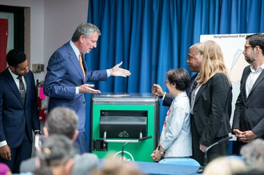 Mayor de Blasio presents a solar trash can as part of the city's new rat reduction program.