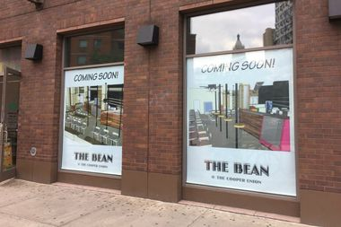 Signage in the windows of the former St. Mark's Bookshop space at 31 Third Ave. advertise The Bean's upcoming location.