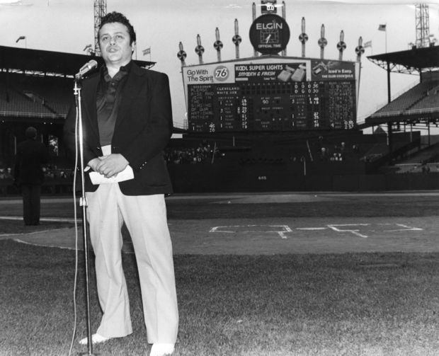 Johnny O's founder Johnny Veliotis sings the National Anthem at Comiskey in 1980.