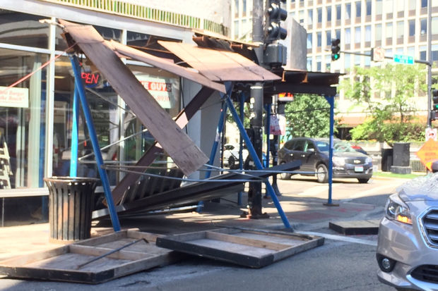 A turning truck took down a section of the scaffolding in front of the Five Guys at Clark and Fullerton Monday.
