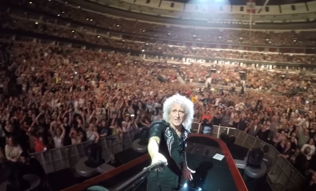 Queen guitarist Brian May uses a selfie stick to film fans at the United Center.