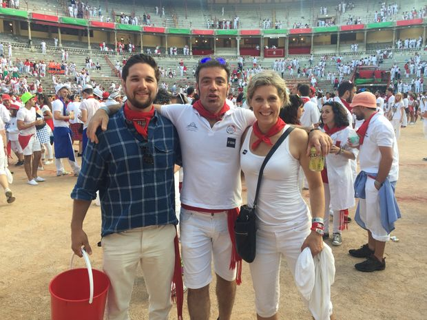 Reporter Mark Schipper, far left, with two Navarrans in Plaza de Toros for San Fermin festivities.