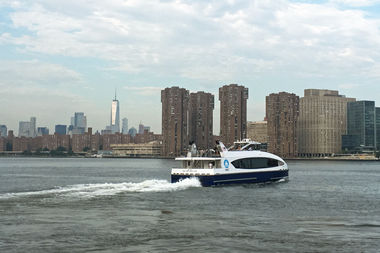 A NYC Ferry boat heads to Manhattan from Long Island City.