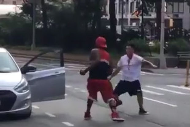 The two men traded blows at Broadway and West 94th Street early Wednesday, video shows.