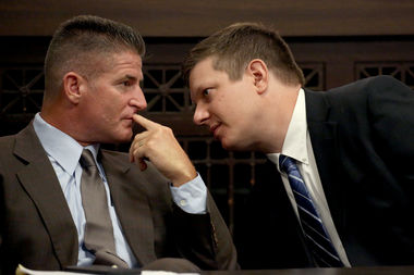 Defense attorney Daniel Herbert (left) chats with client Jason Van Dyke  during a status hearing at the Leighton Criminal Courthouse, 2650 S. California Ave. File photo.