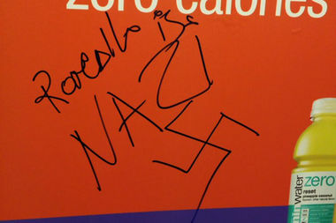 Graffiti featuring swastikas and the word