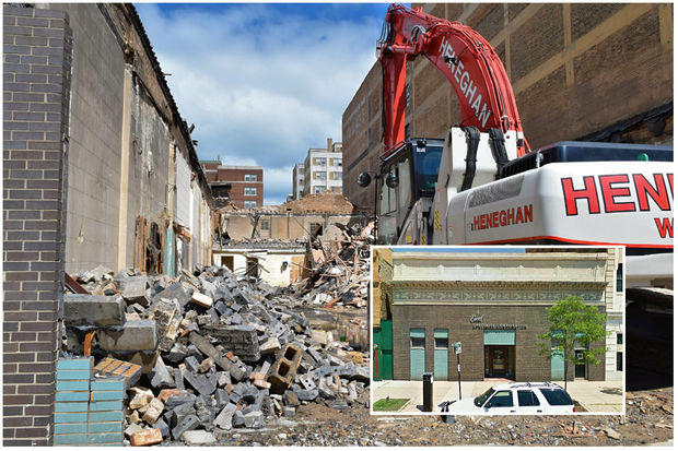 The former Broadway Motor Sales building at 6335 N. Broadway was demolished Monday.