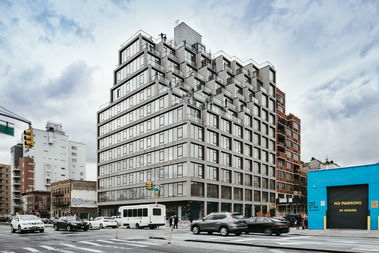 The newcondo building on the corner of First Streetand Fourth Avenue boastsa stroller valet, a pet grooming station and a