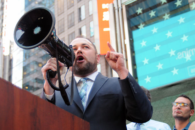 City Councilman Corey Johnson spoke out against President Donald Trump's proposed ban of transgender people in the military during a rally in Times Square Wednesday, July 26, 2017.