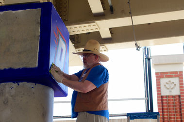 Brother Mark Elder does preparation work on the new murals last Friday.