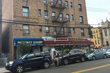 A cyclist on Crescent Street near Newtown Avenue.