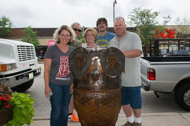 Laura Guenther, president of Everyday Edgebrook and owner of Local Goods Chicago (left) and sculptor Todd Willing flank Eddie the Everyday Edgebrook Owl.