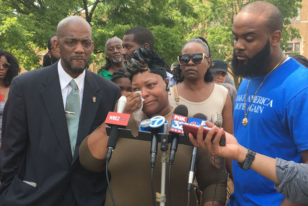Cynthia Lane, center, cries as she discusses the death of her son Roshad McIntosh in 2014. McIntosh was fatally shot by police.