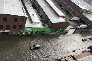 The Gowanus Canal flooded Friday morning after a summer storm pounded the area.