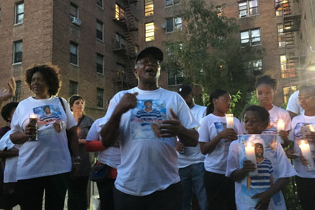 Vibert Jeune, the father of Dwayne Jeune, sings a spiritual at a vigil for his son, who was shot by police on July 31.