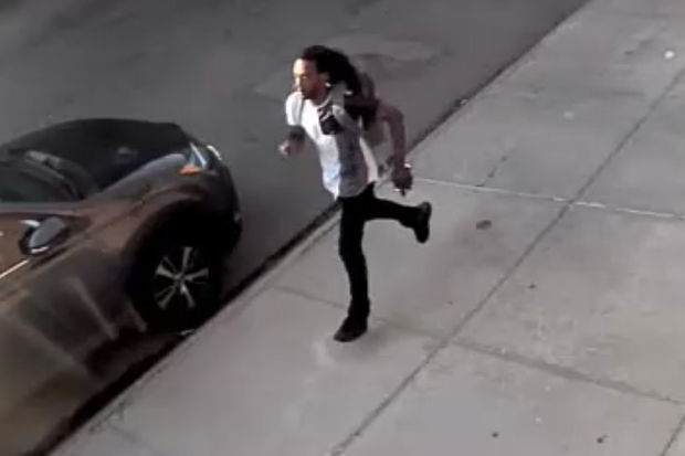 The suspect can be seen running in police footage released Monday. He's wearing a gray and white T-shirt with dark pants and shoes, police said.
