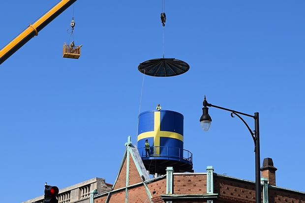 Andersonville's iconic Swedish flag water tower was re-installed atop the Swedish American Museum Tuesday.