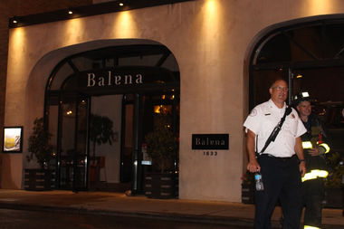 Deputy District Chief John Giordano prepares to leave the scene of a fire at the Balena Restaurant building at 1633 N. Halsted St. Tuesday evening.