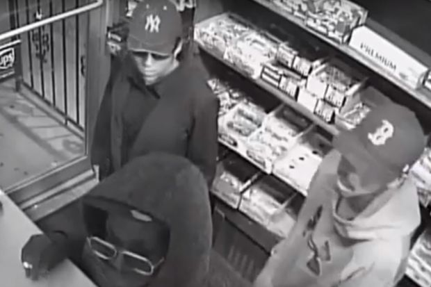 Two stood watch outside while the others pulled a gun on a clerk inside, police said.