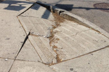 An estimated 80 percent of the city's curbs aren't up to federal law, a new report found.