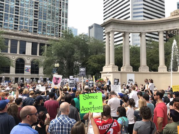 Demonstrators against racism rally Sunday in Millennium Park in the wake of the deadly violence Saturday in Charlottesville, Va.