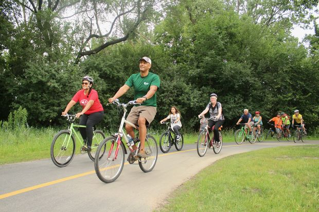 City and county leaders cut the ribbon on the 1.2-mile path extension on Saturday.