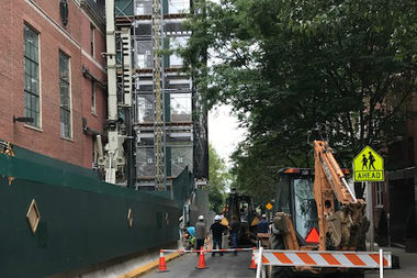 The crew had been drilling support for a tower crane at the time of the water line break, residents said.