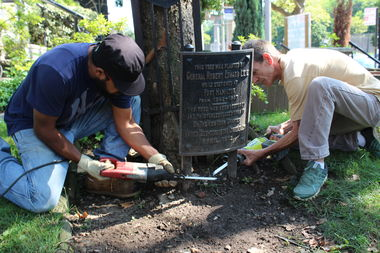 Workers removed a memorial plaque to Confederate General Robert E. Lee at St Johns Episcopal Church on Wednesday amid growing calls for its removal.