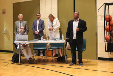 Twenty-seventh Ward Ald. Walter Burnett Jr. (far right) joined representatives of Lincoln Park Community Services at a public meeting on its proposed Old Town outlet earlier this month.
