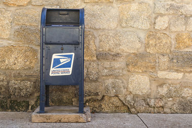 Two men were arrested in Crown Heights for stealing checks and money orders out of a mailbox.