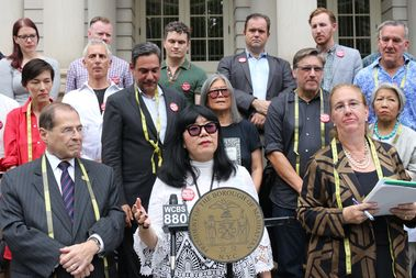 Designer Anna Sui, Assemblyman Richard Gottfried, left, Manhattan Borough President Gale Brewer, right, and other Garment District stakeholders and community board officials at a press conference Friday.