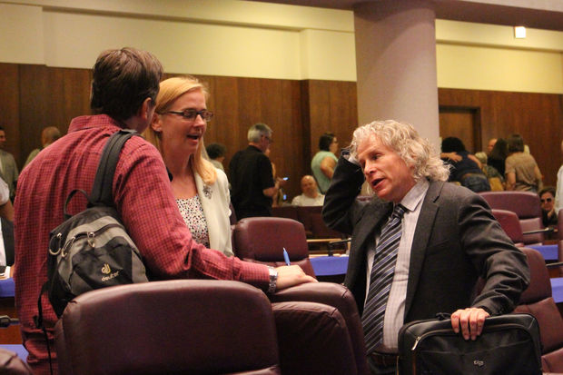 Lydia Barry of Lincoln Park Community Services talks with Old Town resident Mitch Newman after Friday's hearing.