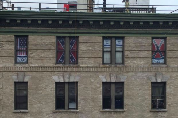A tenant at 403 E. Eighth Street has two Confederate flags displayed in his windows.