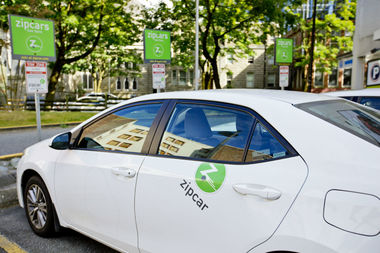 The city is rolling out a car sharing pilot in 15 neighborhoods this fall for companies like Zipcar.