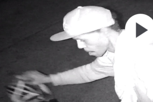 A man prepares to peddle off on a bike in a garage burglary recorded on surveillance video on the 1700 block of North Fremont Street Sunday morning.