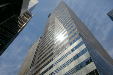 The window washers got stuck outside 900 Third Ave. at about 11:53 a.m., officials said.
