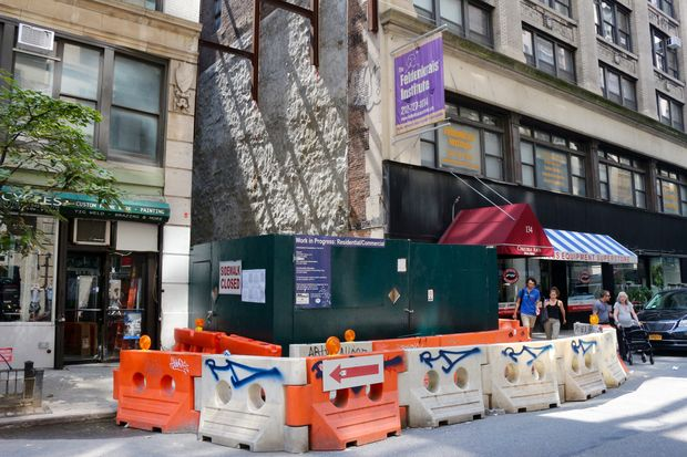 The stalled construction site at 132 W. 26th St., between Sixth and Seventh avenues.
