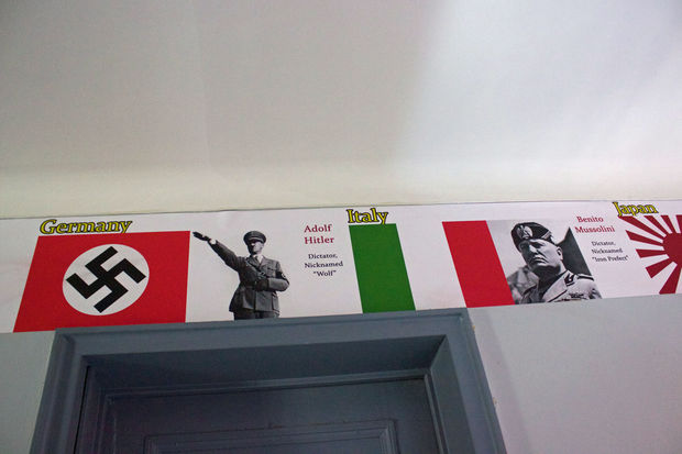 A World War II display on the building's first floor includes pictures of Hitler and Mussolini.