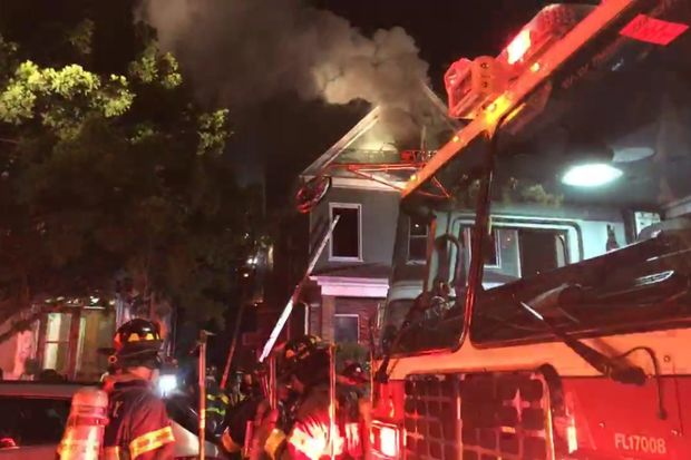 The blaze broke out inside a home on 44th Street near Fort Hamilton Parkway, authorities said.