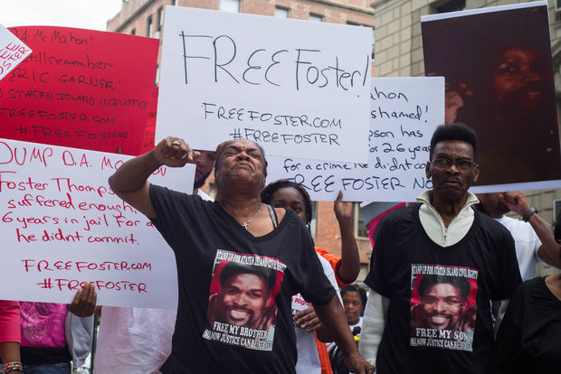 Dozens rallied outside the DA's office calling on him to overturn Foster Thompson's conviction.